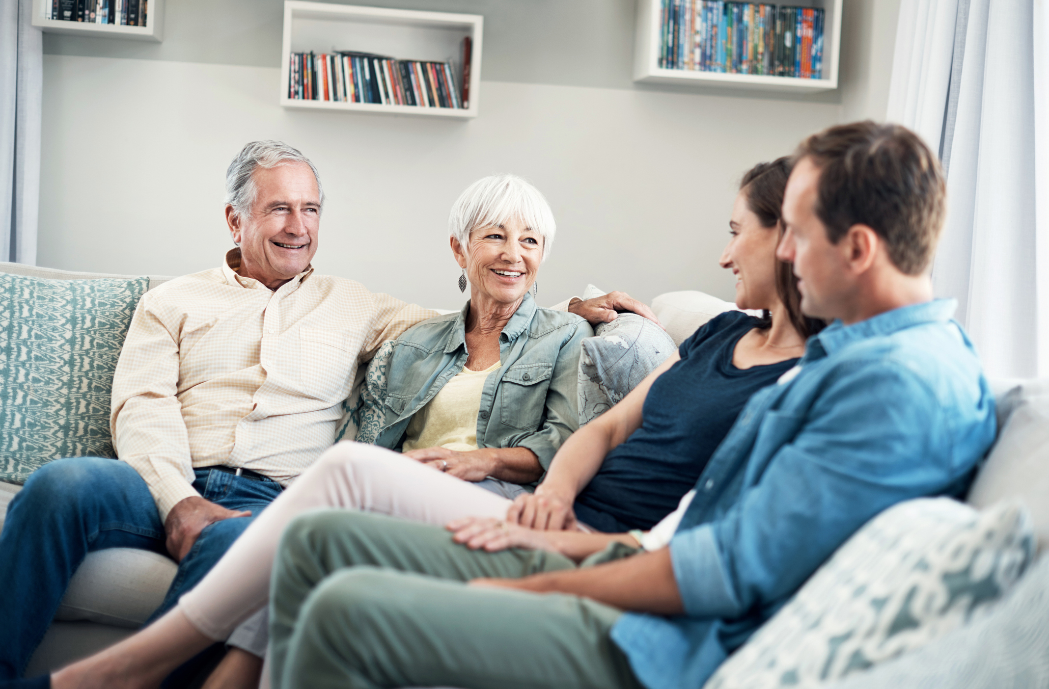 Shot of a young couple and their elderly parent spending some time together at home